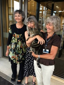 Benjamin the library cat, with three of his staff