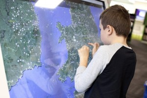 This chap is using an interactive noticeboard to get the most out of Google Earth
