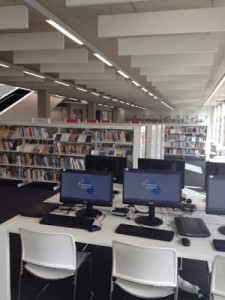 Another picture of Willesden - clean white bookshelves, computers and light