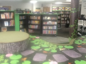 This is the storytime area. The greenery of the other areas turns into a fully fledged woodland theme here.