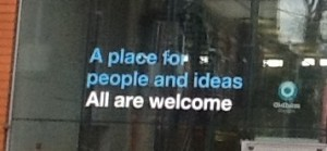 "Sign saying ""A place for people and ideas. All are welcome"". This sign at the entrance to Oldham Library pretty much sums up my entire philosophy of wht a public library is.  All people, and all ideas, are welcome."