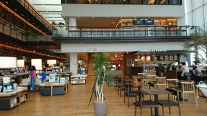 Tagajo Library – Inside. Bookstore section to the left and on the second floor, library is behind the wall of books on the left.  Restaurant  Is barely visible on the 3rd floor.